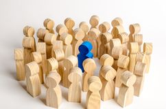 Free The Blue Figure Of The Leader Is Surrounded By A Crowd Of People. Leadership And Team Management, An Example For Imitation Royalty Free Stock Image - 160764566