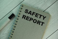 Free The Book About Safety Report Isolated On Wooden Table Stock Images - 213114384