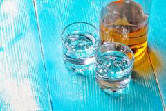 Free The Bottle Of Rum On The Blue Table There Are Two Stock Image - 121573101