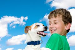 The Boy And His Favorite Dog Against The Blue Sky With White Clouds Stock Photography