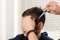 Free The Boy Is Cut Hair With Scissors, Close-up Of A Hairstyle Stock Images - 125754004