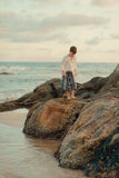 The Boy On The Rocks Royalty Free Stock Photos