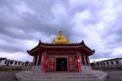 The Buddha Statue Under The Dark Clouds Stock Images
