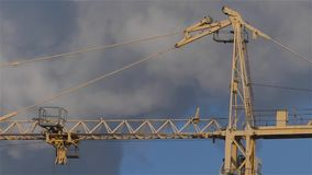 Free The Building Of The House. Crane On The Sky Background And Smoke. Stock Photo - 72374270