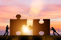 Free The Business Concept Of Teamwork With Jigsaw Puzzle Royalty Free Stock Photography - 84881087