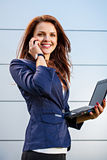 The Business Woman Speaks By Phone Stock Photos
