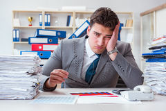 Free The Businessman Busy With Much Paperwork Royalty Free Stock Images - 96337219