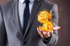 The Businessman Holding Burning American Dollar Sign Stock Image