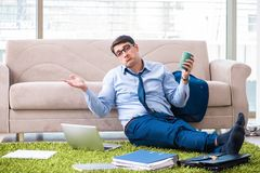 Free The Businessman Taking Work Home And Working Overtime Stock Photography - 124393412