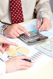 The Businessmen And Calculator Royalty Free Stock Photo