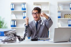 Free The Busy Employee Chained To His Office Desk Royalty Free Stock Image - 115408806