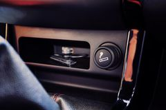 The Car Cigarette Lighter In A Car Interior. Royalty Free Stock Image