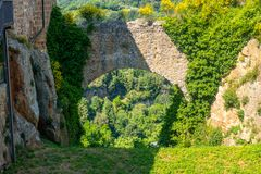 Free The Castle Rocks Of Little Medieval City Of Sorano, Tuscany, Italy, With Hills And Blue Sky In Background Stock Photos - 156289823