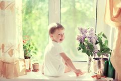The Child At A Window Royalty Free Stock Photos