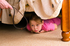 Free The Child Hides Under A Bed. Violence In A Family. Royalty Free Stock Images - 19629469
