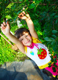 The Child In A Garden Royalty Free Stock Images