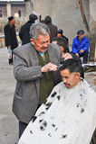 The Chinese Traditional Haircut Stock Photography