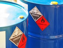 Free The Close-up Shot Of Blue Color Hazardous Dangerous Chemical Barrels ,have Warning Labels Of Corrosive & Flammable Liquid Royalty Free Stock Photos - 186098798