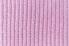 Free The Closeup Texture Of Pink Cashmere Sweater Background. Macro Shot Of Knitted Fabric From Lana Wool Threads Royalty Free Stock Photography - 158761567