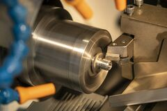 Free The CNC Lathe Machine In Metal Working Process Cutting The Screw Parts With The Cutting Tools. Royalty Free Stock Photography - 168706547