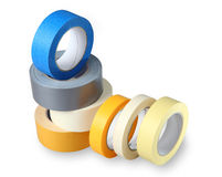 The Composition Of The Seven-colored Rolls Of Duct Tape, Isolate Stock Photo