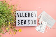 Free The Concept Combating Preventing Seasonal Allergies. Fresh Flowers Medical Mask Pills Drops Medicine Pink Background. Royalty Free Stock Photos - 186046008