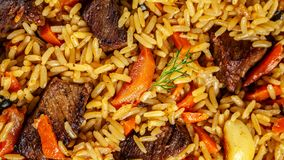 The Concept Of Oriental Cuisine. Texture Of Uzbek Pilaf With Meat, Vegan Pilaf. Top View Royalty Free Stock Photo