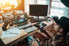 Free The Content Creator Using Mobile Working  With The Laptop Editing Video Footage In The House Studio Royalty Free Stock Images - 159439929