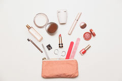 The Contents Of Women`s Handbags. Make Up Bag With Cosmetics Stock Photos