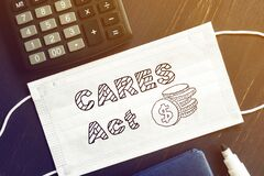Free The Coronavirus Aid, Relief, And Economic Security CARES Act Is Shown On The Photo Stock Photos - 181186663