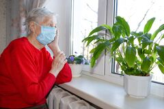 Free The Covid-19, Health, Safety And Pandemic Concept - Senior Old Lonely Woman Sitting Near The Window Royalty Free Stock Images - 176373799