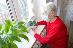 Free The Covid-19, Health, Safety And Pandemic Concept - Senior Old Lonely Woman Sitting Near The Window Royalty Free Stock Photos - 176664038