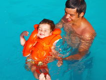 The Daddy Learns To Float The Child Stock Photo
