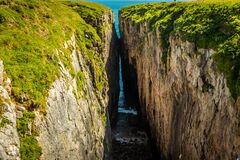 Free The Deep Crevice Of `Huntsman Leap` On The Pembrokeshire Coast, Wales Royalty Free Stock Image - 194753246