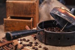 The Device For Roasting Coffee Beans, An Old Hand Grinder. Royalty Free Stock Photography