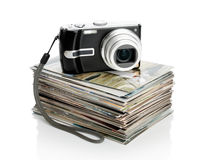 The Digital Camera And The Heap Of Photos Stock Photography