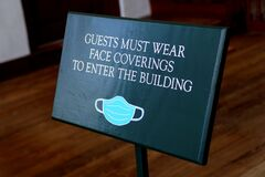 Free The Door Sign Asking Visitors To Wear Mask Before Entering The Building Stock Photo - 188934970
