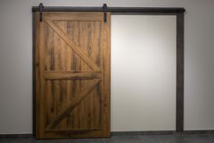 Free The Door To Nowhere. Sliding Wooden Door In The Loft Style With Beautiful Metal Fittings. There Is No Passage Royalty Free Stock Images - 163336069