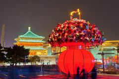 The Drum Tower And A Basket Of Flowers In City Center At Night Stock Images