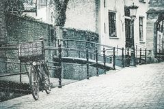 Free The Dutch City Of Gouda With A Bicycle In Front In Winter Stock Photography - 133373292