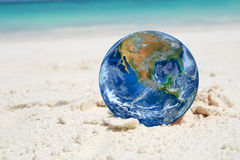 Free The Earth On Sand Beach, Including Elements Furnished By NASA Royalty Free Stock Photo - 69706865