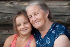 The Elderly Woman With The Grand Daughter Royalty Free Stock Photos