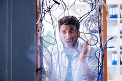 Free The Electrician Trying To Untangle Wires In Repair Concept Royalty Free Stock Photography - 108547587