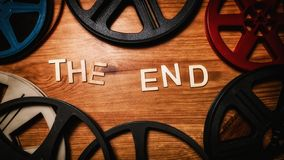 Free The End Wood Letters Bordered By Film Reels Stock Image - 155725411