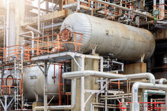 Free The Equipment Of Oil Refining, Detail Of Oil Pipeline With Valves In Large Oil Refinery, Industrial Zone. Royalty Free Stock Photography - 82518567