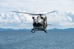 Free The Eurocopter EC 645 T2 Helicopter Of Royal Thai Navy Fly Over The Sea Near Sattahip Naval Base, Chonburi, Thailand Royalty Free Stock Photos - 190431728