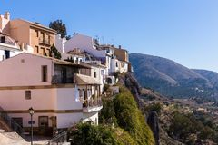 Free The Facades Of The White Houses Of The Spanish Old Town Of Finestrat Are Built In The Mountains. Royalty Free Stock Image - 148550346