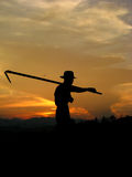 The Farmer When Sunset Royalty Free Stock Photography