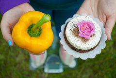 Free The Fat Woman Is Standing On The Scales Selects A Yellow Big Sweet Bell Pepper Royalty Free Stock Image - 93640336