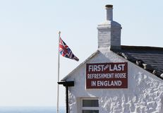 The First And Last Refreshment House In England, Located At Land`s End. The English Flag Waving To The Side. Cornwall, UK Stock Photo
